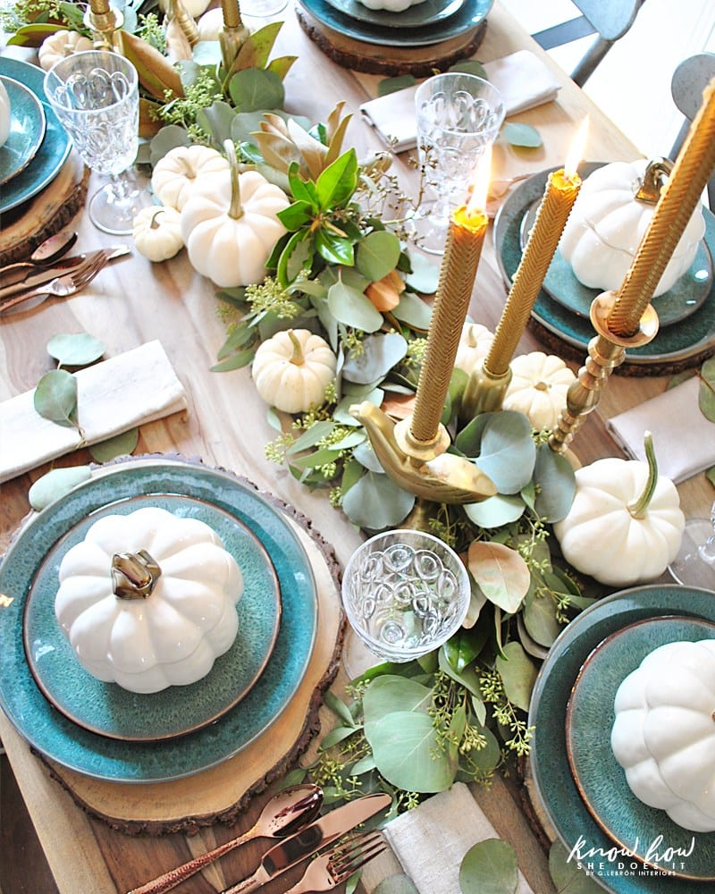 White pumpkins and blue plates Coastal style Thanksgiving table decorations