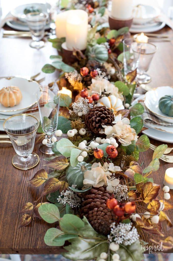 artificial fall garland and pumpkins