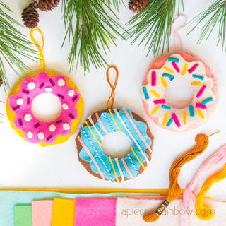 Make easy no-sew felt donut Christmas ornaments. Such fun crafts for kids & family! Unique handmade gifts & trendy DIY decoration ideas. colorful, boho, farmhouse, modern style